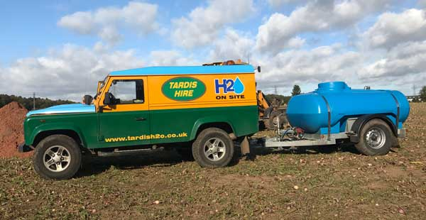 Towable Water Bowser and Land Rover